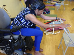 Lesley uses the back of a chair open her front and side chest and to stretch her shoulders.